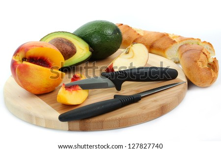 plate with fresh fruits and knife