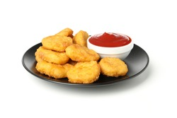 Plate with fried chicken nuggets and ketchup isolated on white background