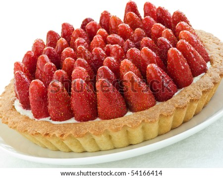 Plate with homemade strawberry tart. Shallow dof.