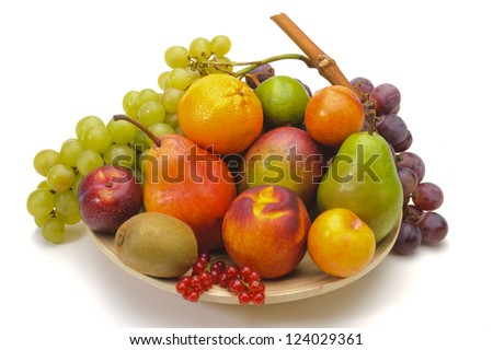 plate with mixed fruits over white background