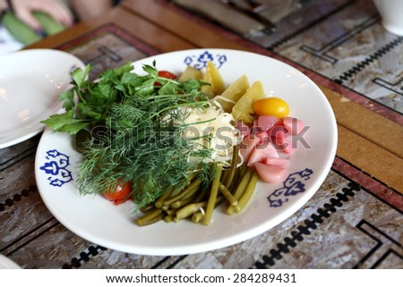 Plate with pickled vegetables in the russian restaurant