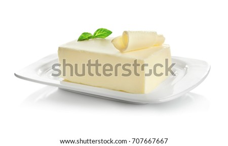 Plate with piece of butter on white background