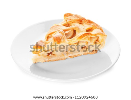 Plate with piece of tasty homemade apple pie on white background #1120924688