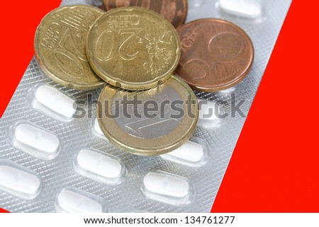 Plate with pills and coins