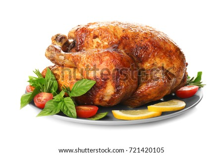 Plate with roasted turkey on white background