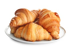Plate with tasty croissants on white background. French pastry