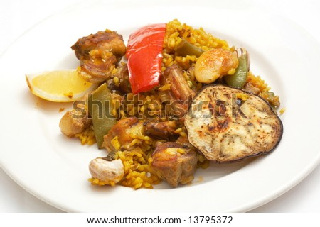 plate with tasty spanish traditional food-paella