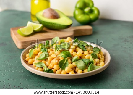 Plate with tasty tasty chickpea on table #1493800514