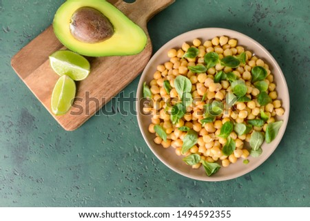 Plate with tasty tasty chickpea on table #1494592355