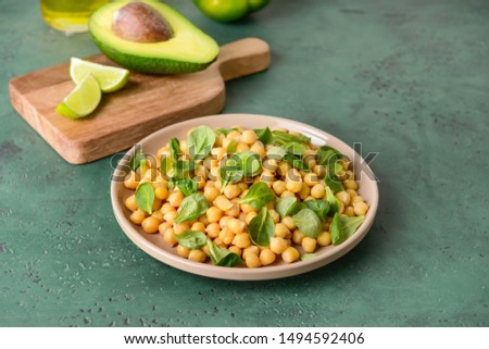 Plate with tasty tasty chickpea on table #1494592406