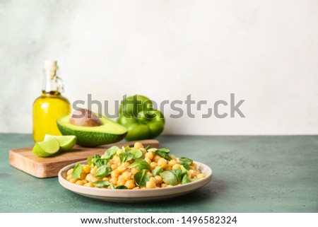 Plate with tasty tasty chickpea on table #1496582324
