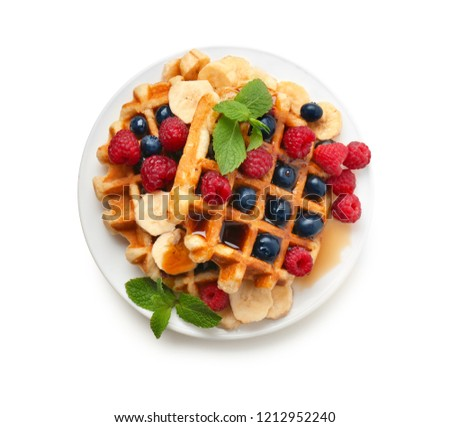 Plate with tasty waffles, fruit and berries on white background Stock fotó ©