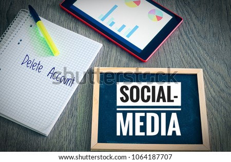 Photo of Plate with the inscription Social Media and Delete Account with a tablet and blockto to symbolize the data scandal