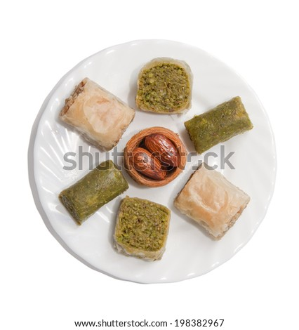 Plate with turkish baklava isolated over white background