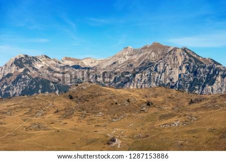 Plateau of Lessinia, Regional Natural Park of Lessinia, San Giorgio, Verona, Veneto, Italy. In the background the Italian Alps (Carega Mountain) #1287153886