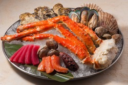 plateau of seafood on ice: salmon, tuna, octopus, crab, mussels