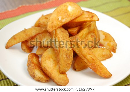 Plateful of seasoned potato wedges