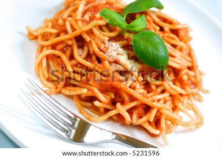 of spaghetti with delicious tomato sauce and sprinkling of parmesan ...