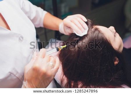 Platelet rich plasma injection procedure. Hair growth stimulation. PRP therapy process.