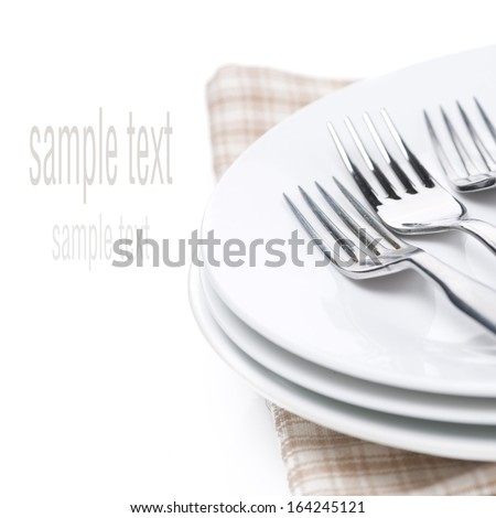 plates and forks - utensils for serving, isolated on white