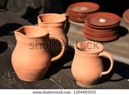 plates and jugs of pottery with red clay #1204485031
