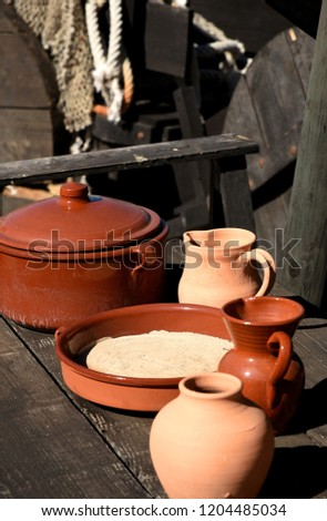 plates and jugs of pottery with red clay #1204485034