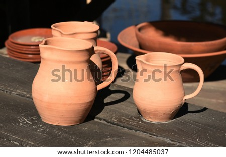 plates and jugs of pottery with red clay #1204485037