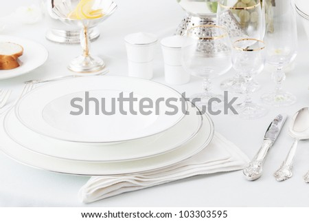 plates, glasses and silverware on the holiday table