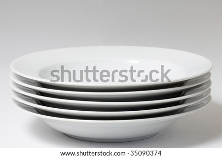 Plates in a stack shot in a studio - stock photo