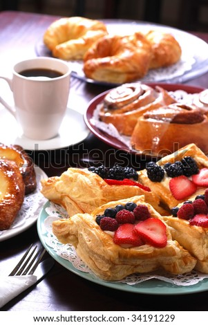 Plates of assorted pastries with coffee at cafe
