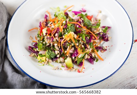 Plates with Colorful Mixed Vegetables and Greens Salad #565668382