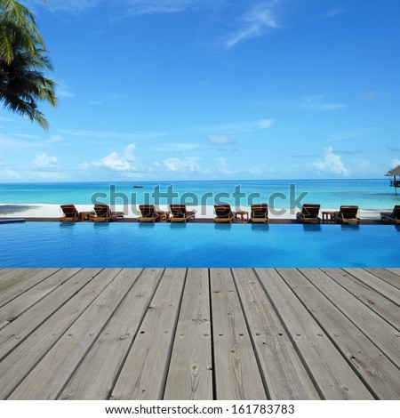 Platform beside swimming pool in maldives beach resorts