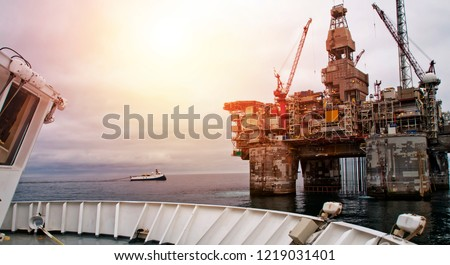 Platform support vessels and seismic boats at close distance to Norwegian Drill Rig on North Sea #1219031401
