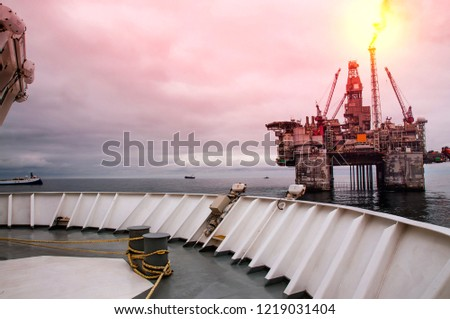 Platform support vessels and seismic boats at close distance to Norwegian Drill Rig on North Sea #1219031404