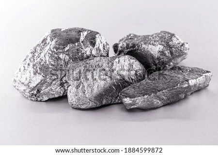 Platinum nugget on an isolated white background, is a chemical element used in the chemical industry as a catalyst for the production of nitric acid, silicone and benzene. Сток-фото ©