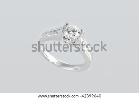 Platinum ring with diamonds over white background