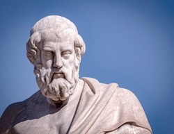 Plato the ancient Greek philosopher white marble bust sculpture under blue sky background