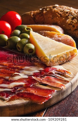 Platter of antipasti appetizers, with crusty bread (shallow dof)