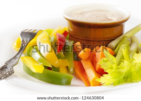 Platter of assortment of fresh vegetables with dipping sauce made of feta cheese