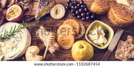 Platter of cheese and fruit pairings food photography recipe idea #1102687454