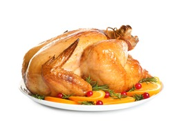 Platter of cooked turkey with garnish on white background