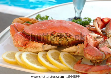 Platter of crab on a table at poolside
