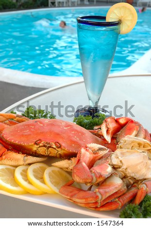 Platter of crab with lemons and parsley out by the pool