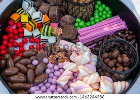 platter of lollies - musk sticks, chocolate, marshmallow, sprinkle covers chocolate, licorices