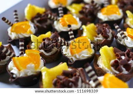 Platter of orange cream chocolate basket mini desserts filling the frame