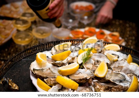 Platter of Oysters and serving champagne