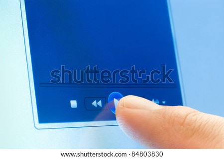 play button on touch screen device with copy space