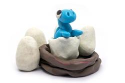 Play dough Baby Brachiosaurus on white background. Handmade clay plasticine