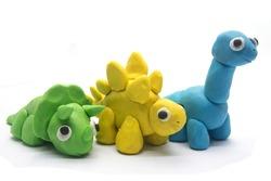 Play dough dinosaur on white background. Handmade clay plasticine