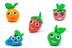 Play dough Fruit imitation on white background. Handmade clay plasticine